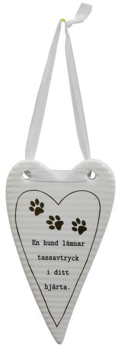 Hjärta: en hund lämnar tassavtryck ...