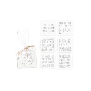 Glasunderlägg med text i låda