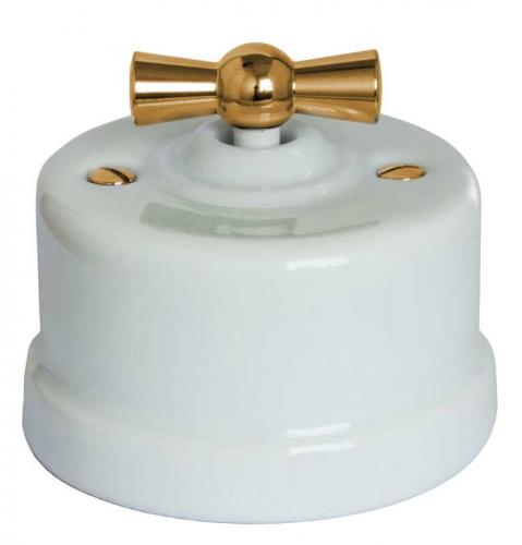Switch - White porcelain surface mounted brass knob