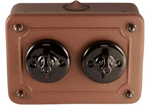 Two-way porcelain switches in metal box - black porcelain/aged metal