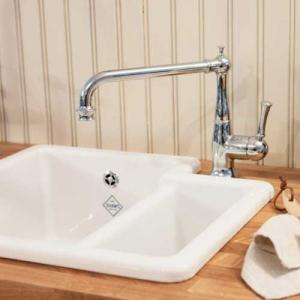 Old-fashioned  double sink in porcelain and kitchen mixer in chrome