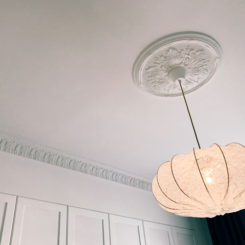 Beautiful ceiling rose in old style - old fashioned style - vintage interior - classic style - retro