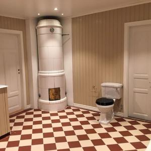 Inspiration - Bathroom with tiled stove