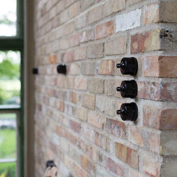 Inspiration - Black porcelain against brick wall