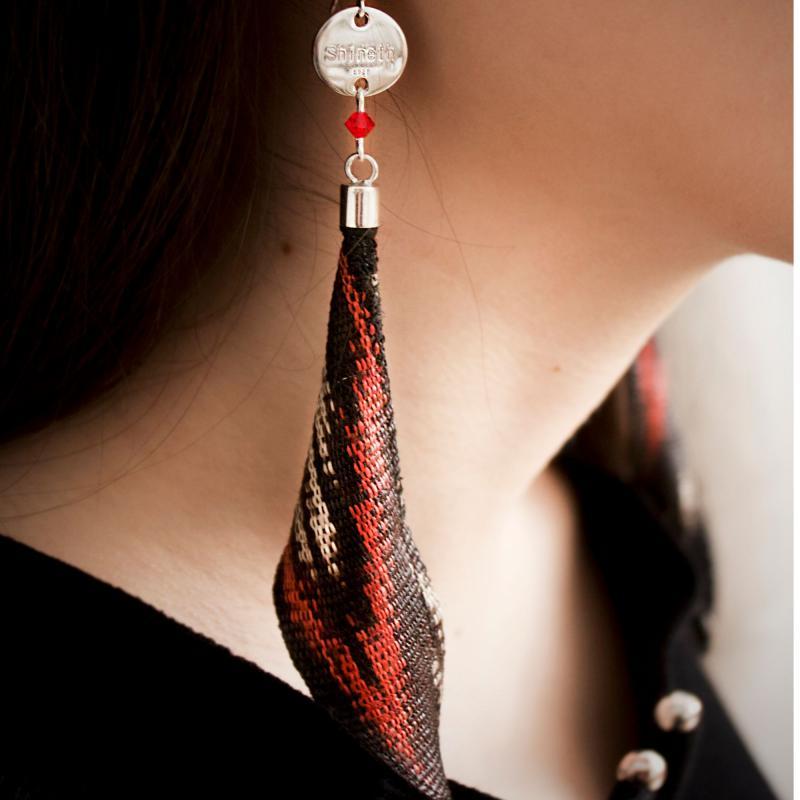 Eleganta T'nalak örhängen i äkta silver