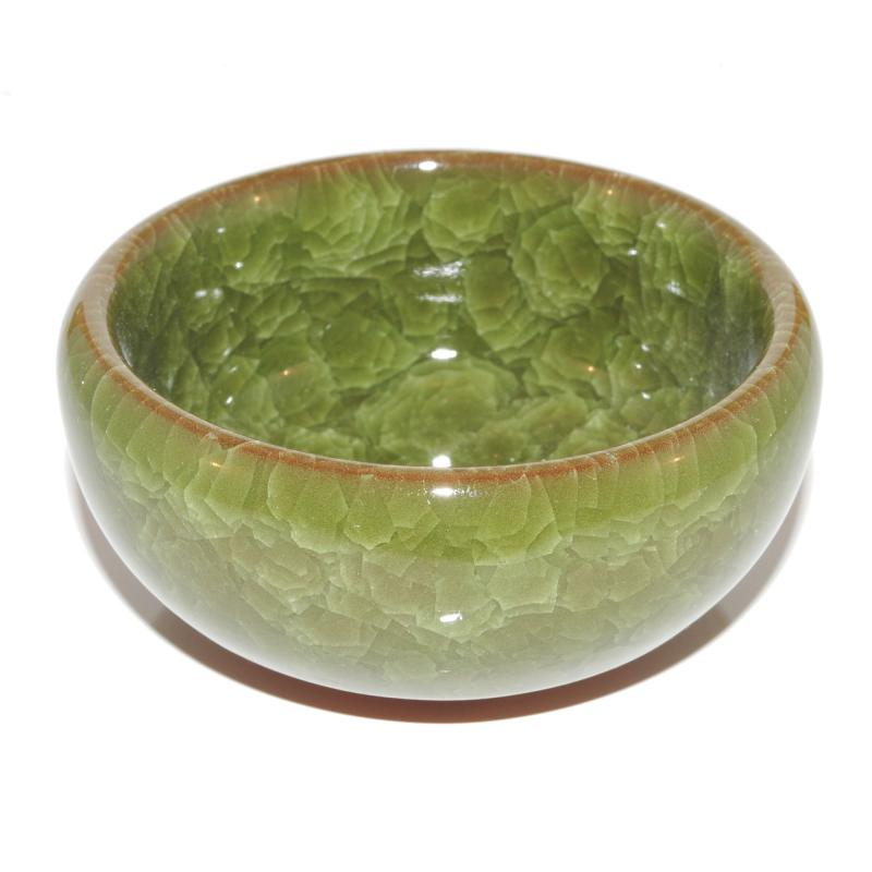 Liten grön keramikkruka
