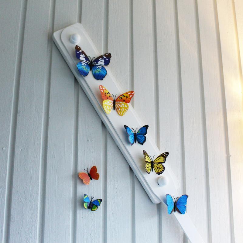 Dekorationsfjäril på vägg