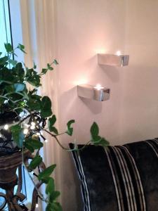 STIL, väggljushållare