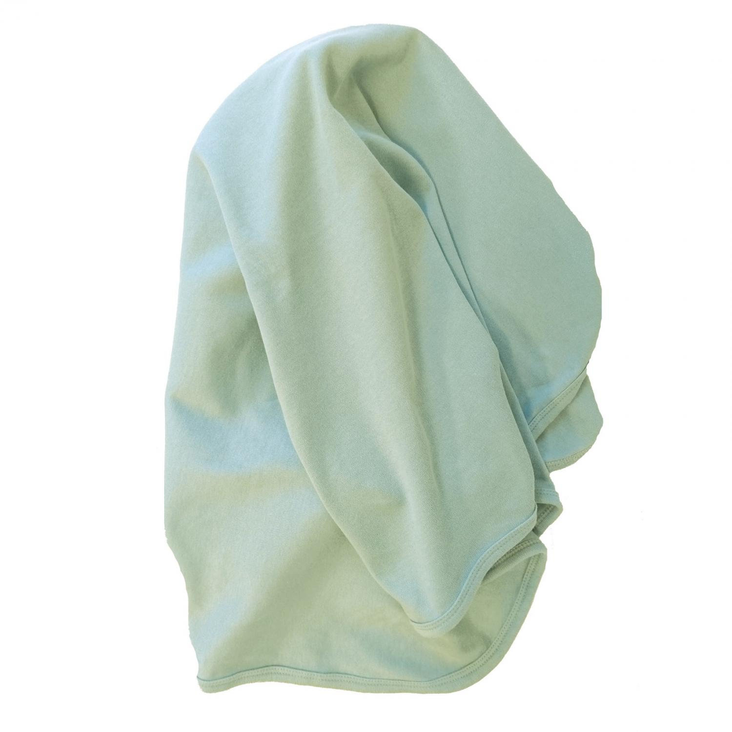 Baby blanket in soft mint color. Organic and GOTS-certified cotton.