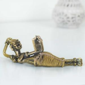 Brass figurine of a women reading and relaxing with her book