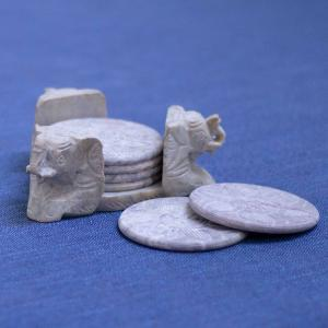 Soapstone coaster set with three animal heads and floral motifs