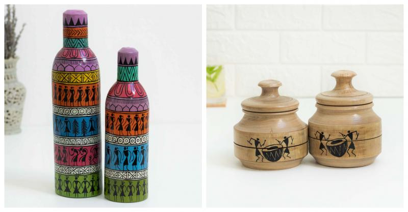Two colorful bottles with tribal motifs on the left placed on a white surface with a vase of dried flowers and two wooden jars with tribal motifs on the right placed on a white surface with a glas of water with mint and a white wall in the background.