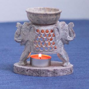 Soapstone diffuser featuring two elephant heads on opposite sides of the piece.
