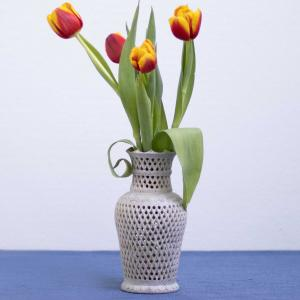 Vase with intricate flower carvings made from soapstone