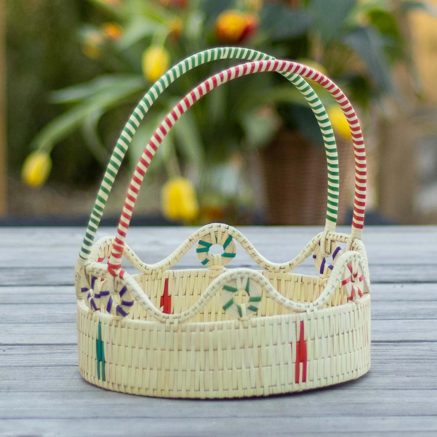 Palm leaf and golden grass basket with red and green handle