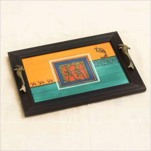 Wooden Tray with a base of orange and blue brass and brass motif at the centre with fish handles and warli dancing picture