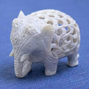 Intricately soapstone elephant sculpture with a baby elephant inside