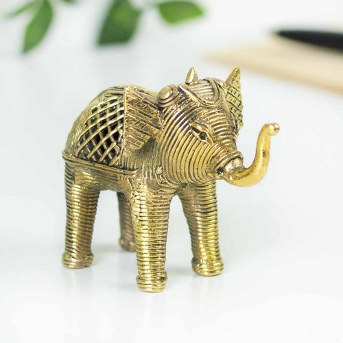 A royal baby elephant made of brass with latticework