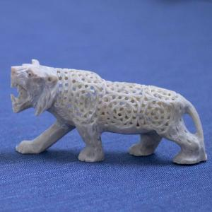 Soapstone cat shaped figurine with a variation of natural stone hues