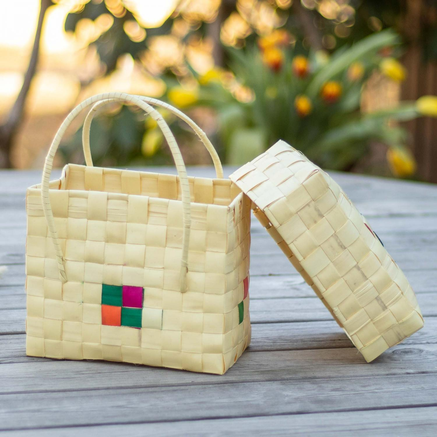 Beige palm leaf box with a small red and green decoration