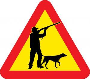 Varningsskylt med jägare & hund