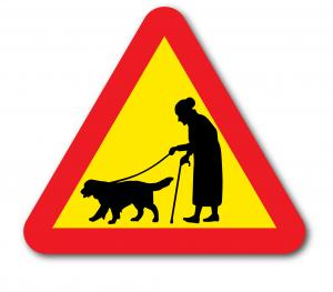 Skylt åldring med hund, gumma