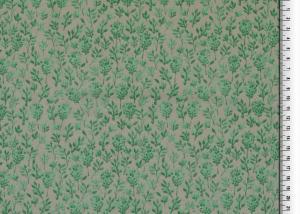 Trikåtyg dekorerat med en grön kvist
