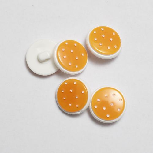 Orange knapp med prickar