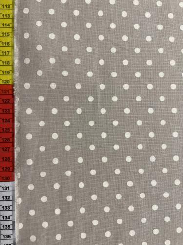 Bomullstyg med grå botten och vita prickar