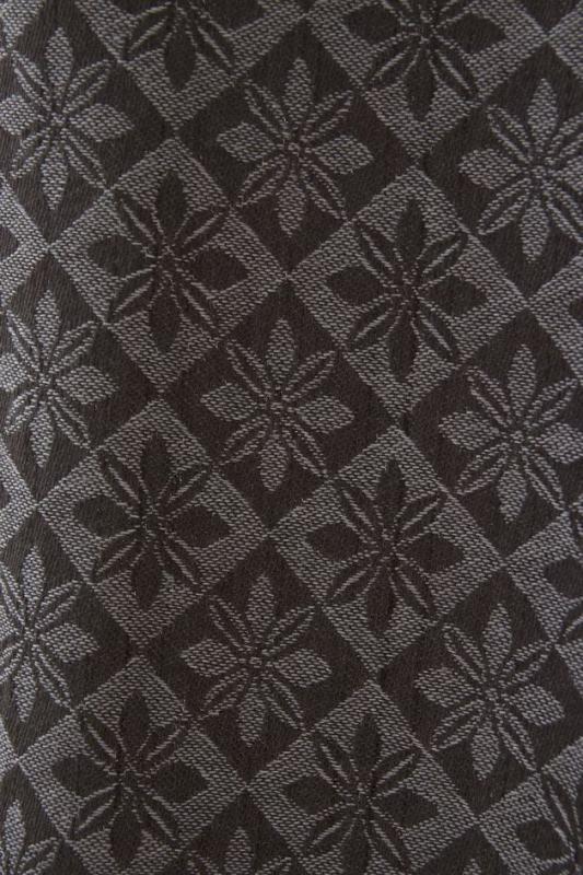 Vävd metervara från Svanefors i bolstermönster/madrasstyg, blåsvart. Finns även i färgerna rosa, beige, blå, ockragul som vävs med vit varp