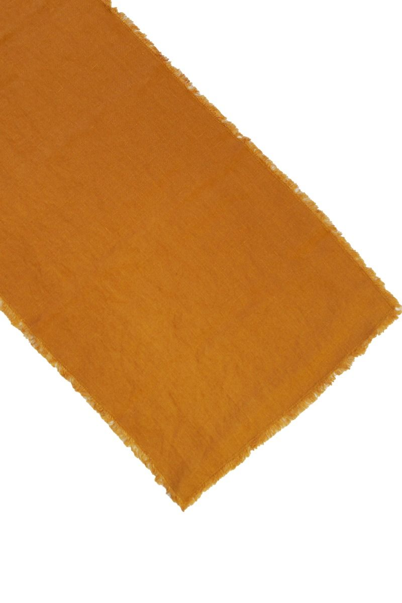 orange bordslöpare med fransad kant i lin