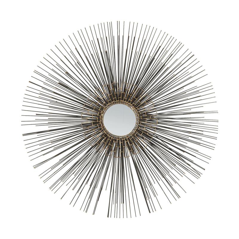 En rund spegel som smyckar väggen - Wohnzimmer.se