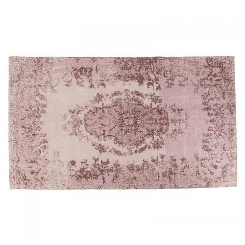 En fin matta med diskret mönster i nyanser av puder.