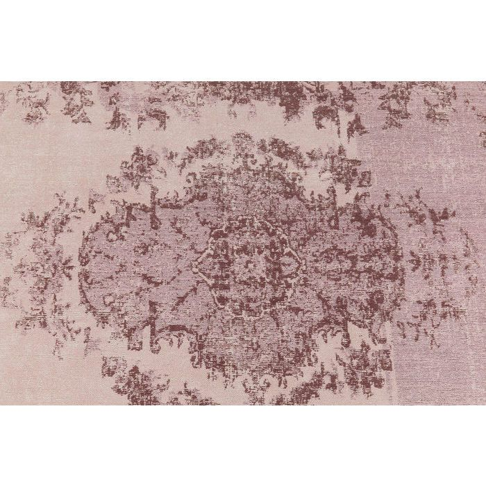 En matta med fint, diskret mönster från wohnzimmer.se