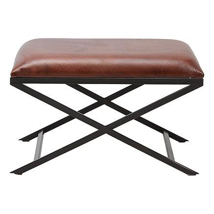 En stilren pall med svar kryssunderrede och sits i brunt läder