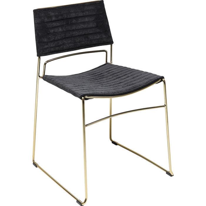 En elegant och minimalistisk stol i mässing och svart
