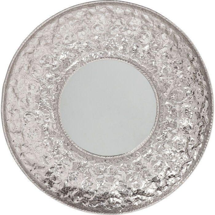 En stor rund silverspegel med vacker bred ram.