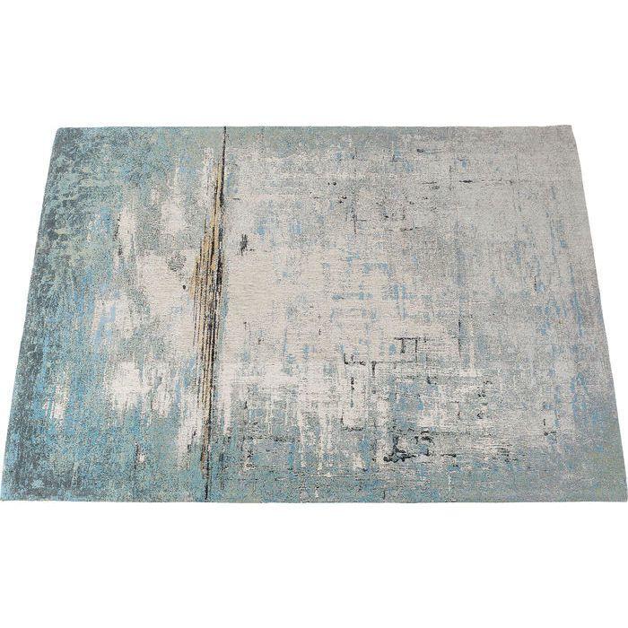 En vacker matta med abstrakt mönster i grå, blå och beige färgton från wohnzimmer.se
