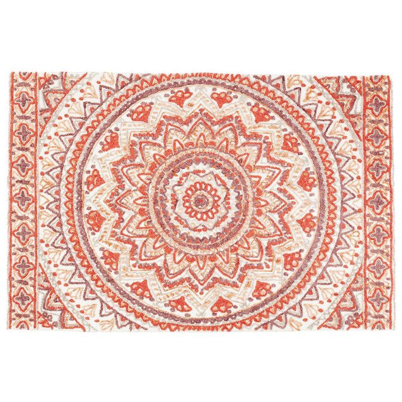 En fantastisk handtuftad matta med orientaliskt mönster i varma färger