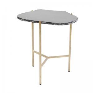 Ett unikt litet bord i svart granit och mässing