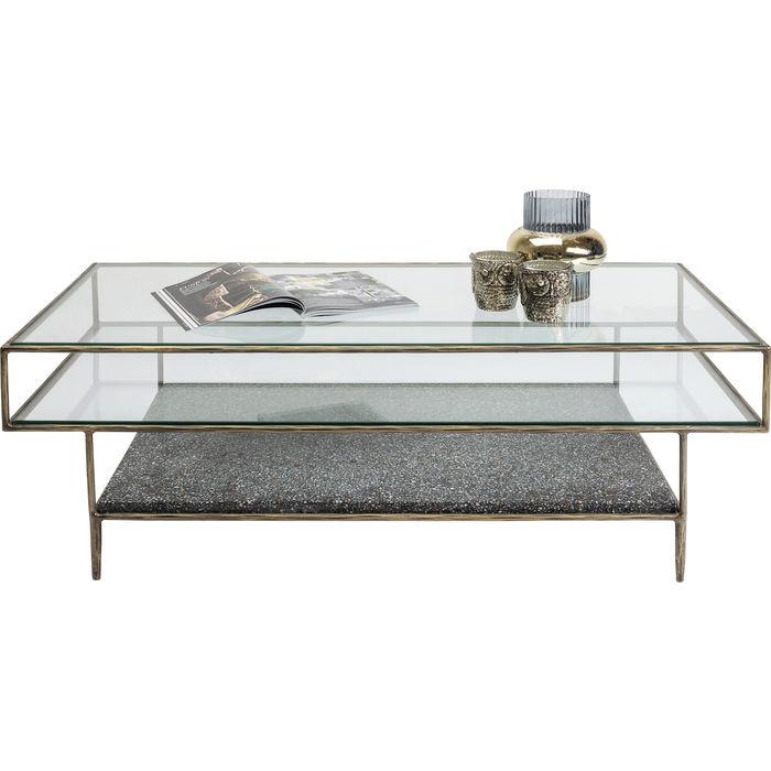 Ett elegant soffbord med genomtänkt design och fina detaljer i glas, betong och mässing.