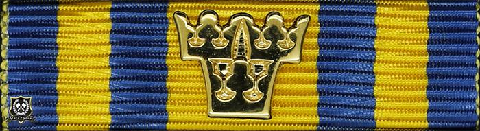Försvarsmaktens tjänstgöringsmedalj för rikets försvar i guld med tre kronor