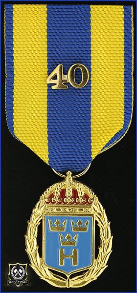 Hemvärnets tjänstgöringsmedalj i guld och emalj med parmonterad siffra för 40 tjänsteår