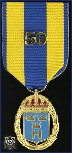 Hemvärnets tjänstgöringsmedalj i guld och emalj med parmonterad siffra för 50 tjänsteår