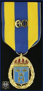 Hemvärnets tjänstgöringsmedalj i guld och emalj med parmonterad siffra för 60 tjänsteår